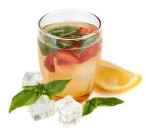 adding basil and strawberry to your water makes a new, exciting drink.