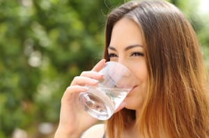 Happy woman drinking water from a UKF8001 filter