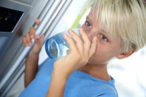 boy drinking filtered water from UKF8001 filter