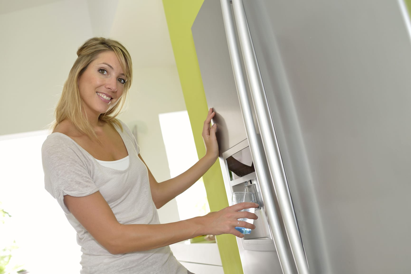 lady dispensing clean ukf8001 filtered water