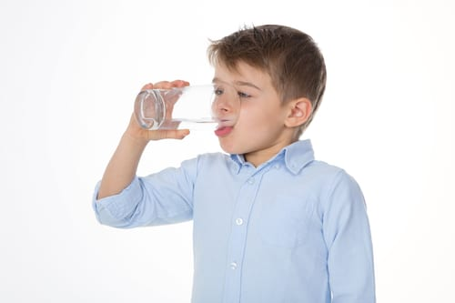 little boy with glass of water