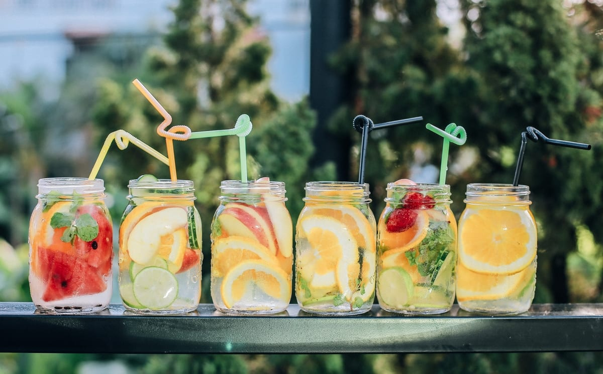 Mixed fruit in water glasses